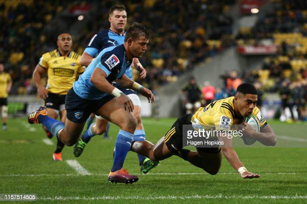 Salesi Rayasi of the Hurricanes beats Handre Pollard of the Bulls to score a try during the Super Rugby Quarter Final match between the Hurricanes...