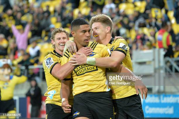 Salesi Rayasi of the Hurricanes celebrates scoring a try during the round 11 Super Rugby match between the Hurricanes and Chiefs at Westpac Stadium...