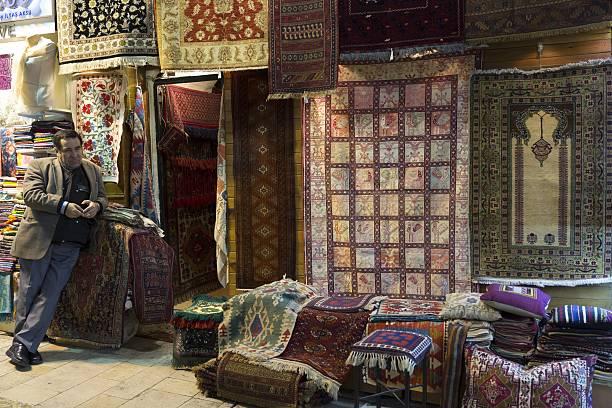 Salesman At Turkish Carpet Rug Shop In The Grand Bazaar Kapalicarsi Great Market