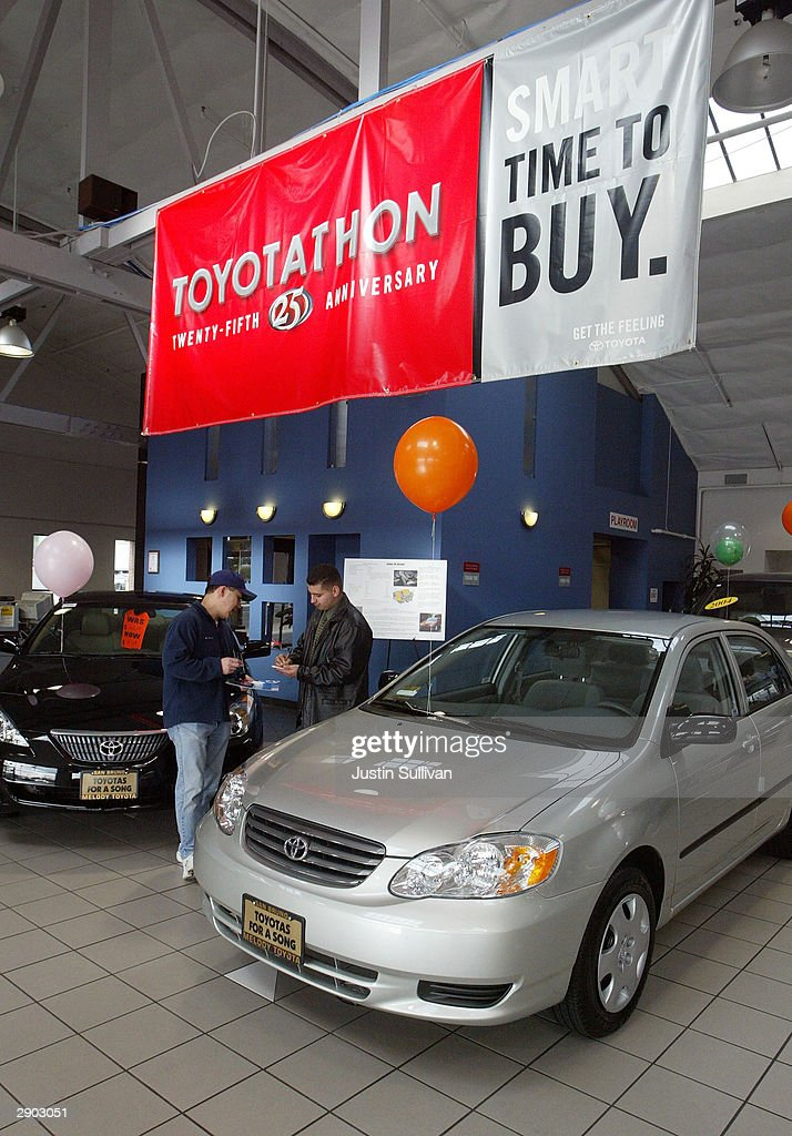 Superior A Salesman Helps A Customer At Melody Toyota January 26 2004 In San Bruno  California Toyota
