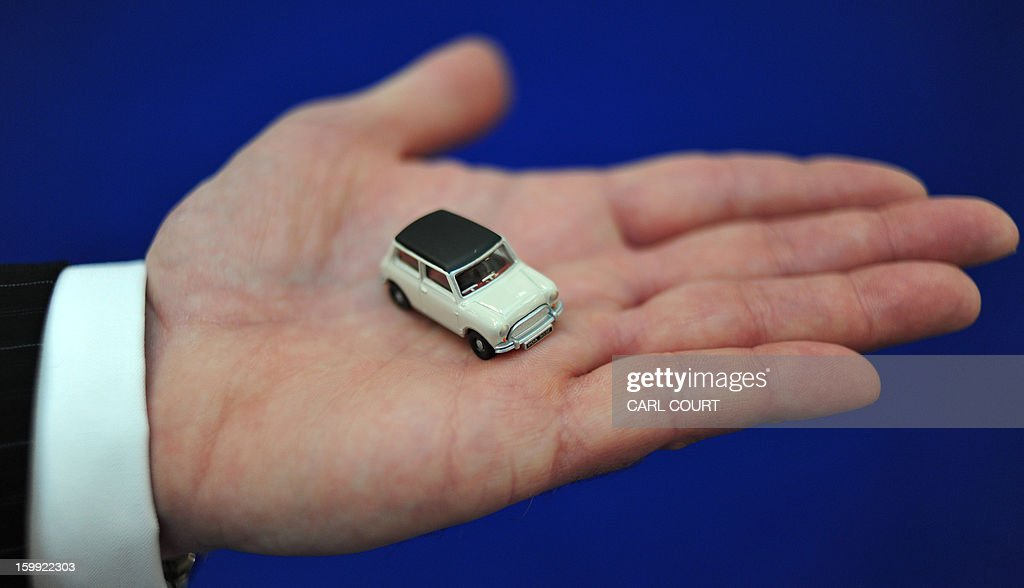 A Salesman Holds A Mini Car Toy At The London Toy Fair In Olympia