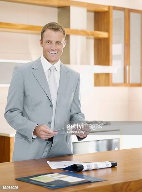 Salesman in interior design showroom