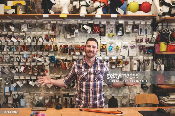 salesman in sports store - climbing equipment stock pictures, royalty-free photos & images