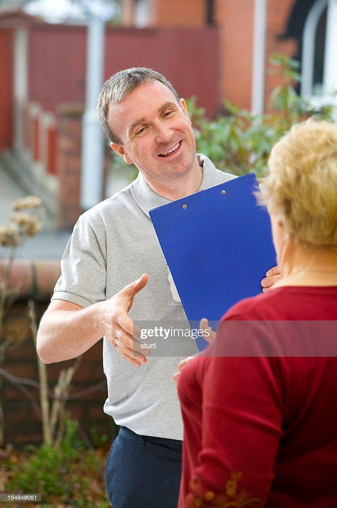 Salesman introduces himself : Stock Photo