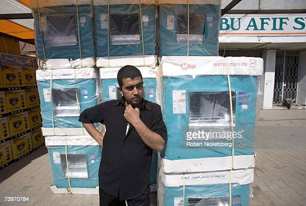 A salesman leans against imported Iranian coolers in the Karrada neighborhood on March 4 2007 in Baghdad Iraq Since the US invasion in 2003 trade...