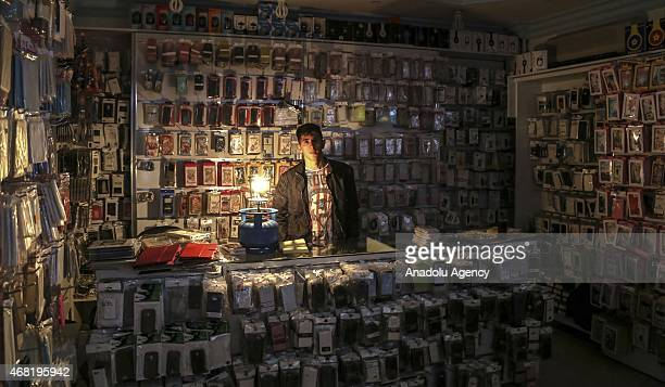 A salesman lightens his shop when a major power outage hit cities and provinces across Turkey on Tuesday 31st March 2015 including eastern city of...