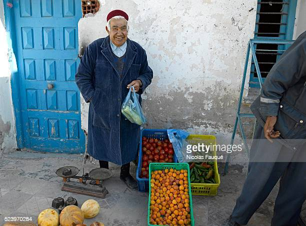 Salesman of fruits and vegetables in the streets of the Jewish district of Hara Kebira in the suburb of Houmt Souk on the island of Djerba Tunisia
