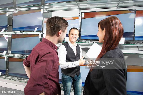 Salesman presenting his offer in an electric shop