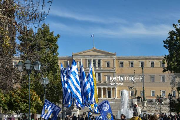 Salesman sales greek flagks in syntagma square,in front of the Greek parliament in Athens, 24 January, 2019. The discussion and processing of the...