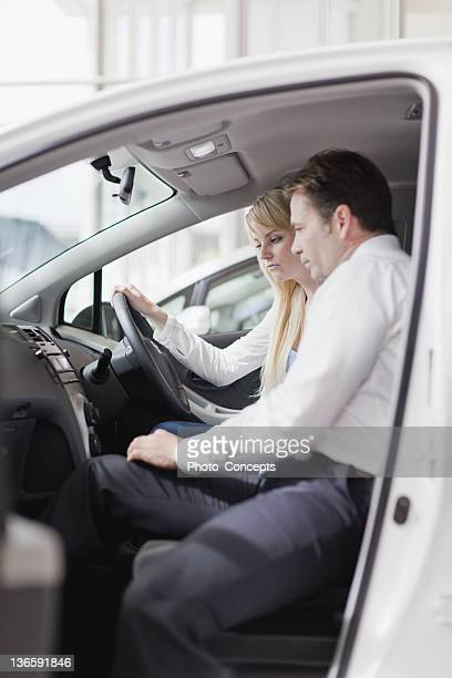 salesman showing car to customer - test drive stock pictures, royalty-free photos & images