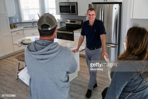 A salesman speaks to customers during a tour of 'The Islander' model mobile home at the LeeCorp Homes Inc dealership in Estero Florida US on Tuesday...