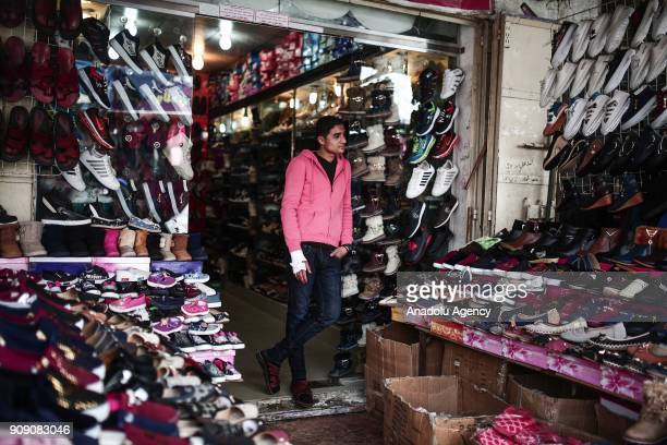 A salesman stands in front of a shop in Gaza City Gaza on January 17 2018 Israel's blockage on Gaza which continues for 10 years has affected people...