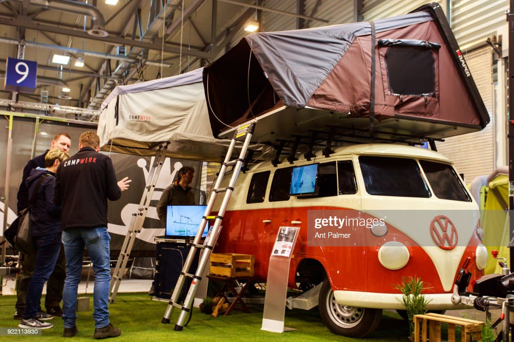 A salesman talks to customers at the Reise + Camping Exhibition on February 21, 2018 in Essen, Germany. The annual event features over 1000 exhibitors from over 20 countries.