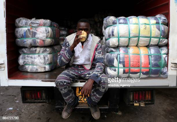 A salesman waits for customers to sell his second hand clothes at Gikomba market in Nairobi Kenya on April 3 2017 Kenyan government's exhortation on...