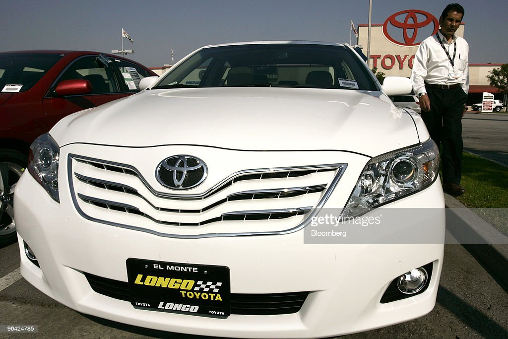A Salesman Walks Past A Toyota Camry At Longo Toyota In El Monte California  US On