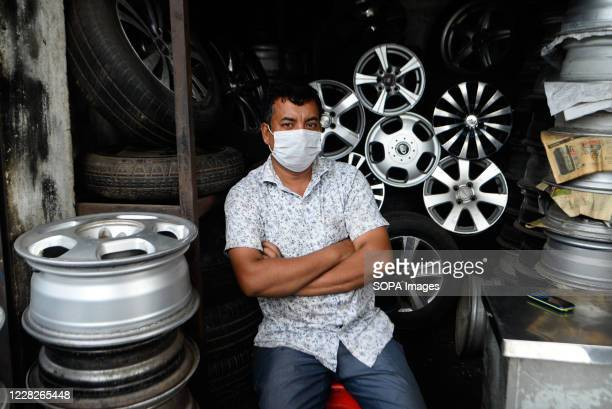 Salesman wearing a face mask as a preventive measure seen at Dholaikhal Automobile Spare Parts and Accessories Market. Dhaka is getting back to its...