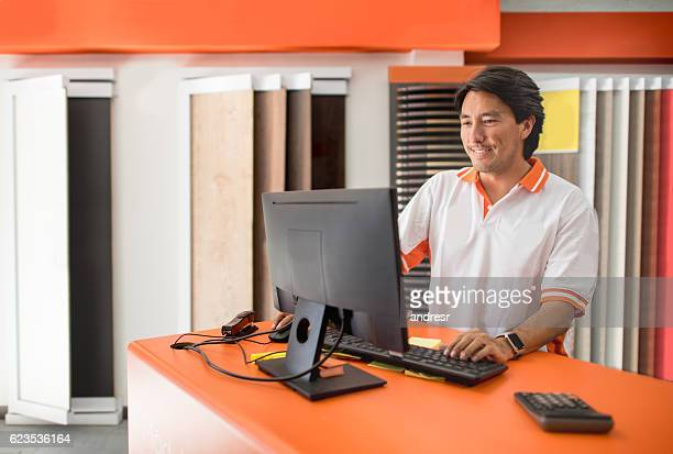 Salesman working at a furniture store
