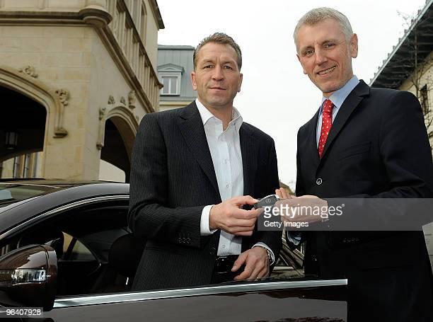 Salesmanager of Mercedes Benz Frankfurt Heerstrasse Alexander Kuehmichel hands over the keys of the new Mercedes Benz car to Andreas Koepke...