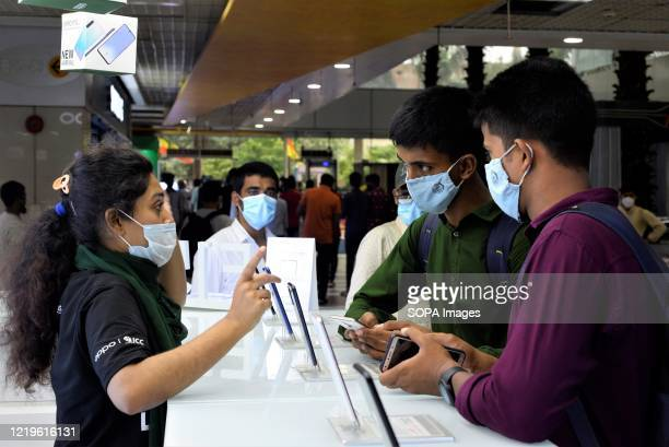 Salesmen at a mobile store wearing face masks as a precaution against the spreed of coronavirus during the eased restrictions. Lockdown in Bangladesh...