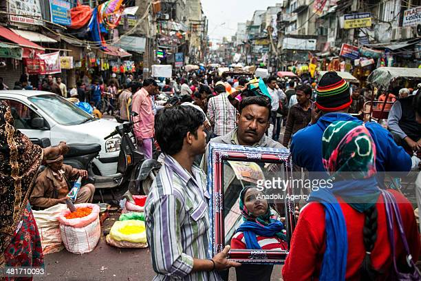 Salespeople sell their products at an open market in the busy streets of New Delhi's Shahjahanabad the walled old city part of India's capital on...