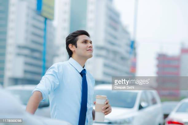 salesperson at car dealership selling vehichles stock photo - south asia stock pictures, royalty-free photos & images