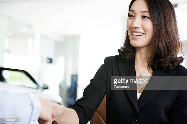 Salesperson Shaking Hands With  Customer