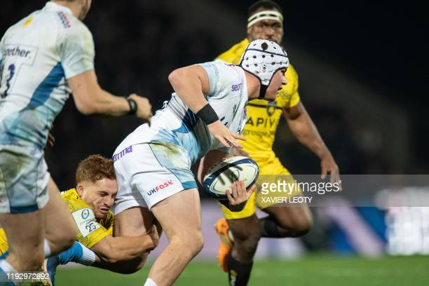 Sales's Curtis Langdon runs with the ball during the European Rugby Champions Cup match between La Rochelle and Sale Sharks at the Marcel Deflandre...