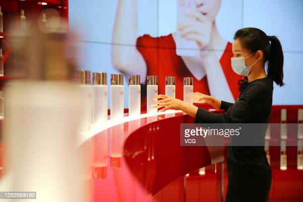 Saleswoman arranges cosmetics at a duty-free shop on June 30, 2020 in Haikou, Hainan Province of China.