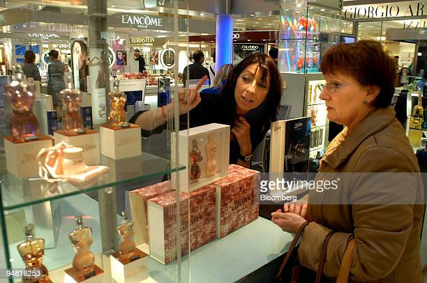 A saleswoman assists a shopper in a department store in Paris France Saturday April 16 2005 Retail sales in the 12 nations sharing the euro fell for...