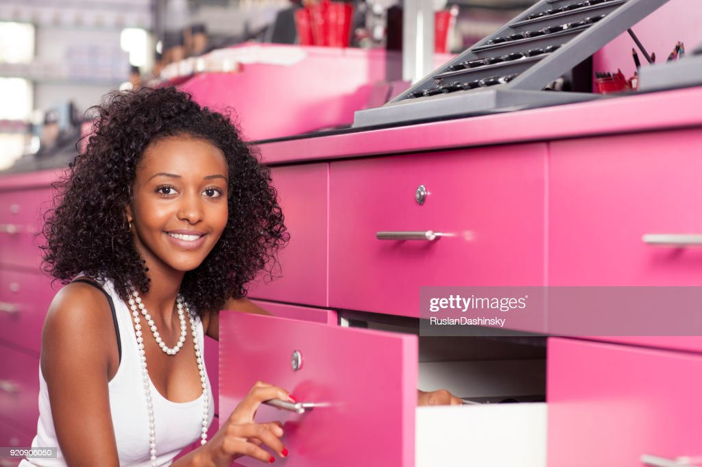 Saleswoman at make-up store. : Stock Photo