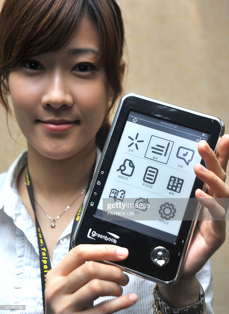 A saleswoman displays an electronic book reader at the Computex Taipei, Asia's largest hi-tech trade show on June 3, 2010. Taiwan's Green Book Inc. unveiled at the fair what it called the world's lightest electronic book reader weighing just 180 grams (0.4 pounds), as e-book makers gear up to the challenge of Apple's iPad.