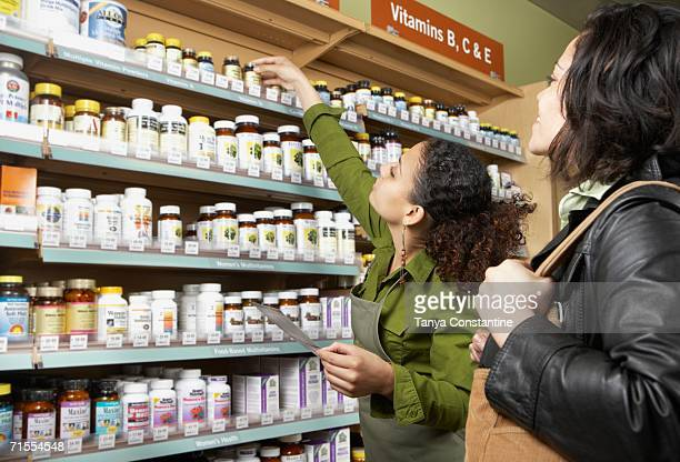 Saleswoman helping customer in health food store