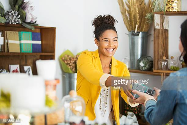saleswoman helping customer - happy merchant stock pictures, royalty-free photos & images