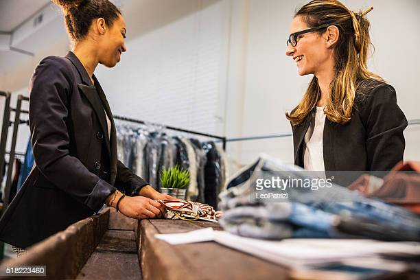 Saleswoman helps customer to choose the right one