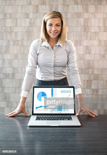 Saleswoman making a presentation with a computer