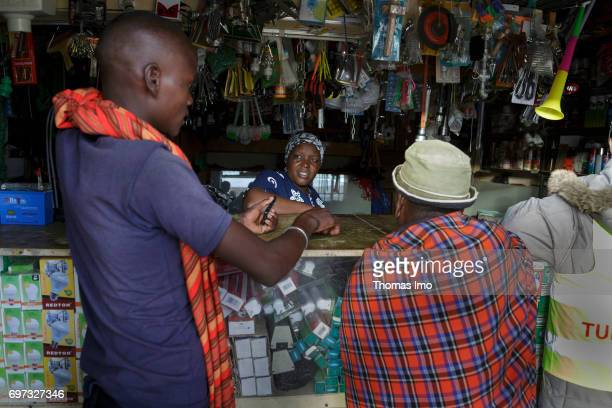 A saleswoman of a shop for household goods is talking to two customers on May 17 2017 in Talek Kenya