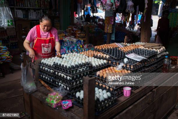 saleswoman of eggs. - laotian culture stock pictures, royalty-free photos & images