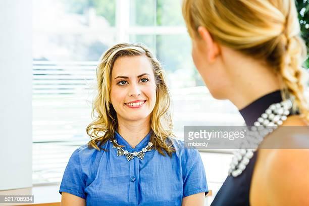 Saleswoman presenting offer to customer