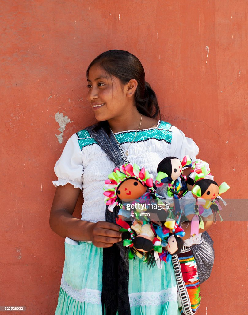 Saleswoman selling Mexican dolls : Stock Photo