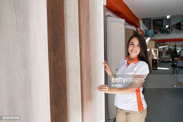 saleswoman working a flooring store - laminate flooring stock pictures, royalty-free photos & images