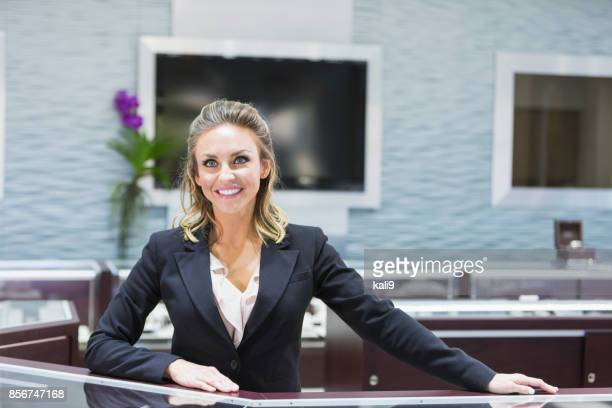 saleswoman working in jewelry store - jeweller stock photos and pictures