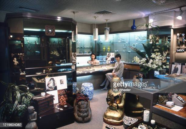 saleswomen inside high end jewelry and antique store in Hong Kong circa 1985