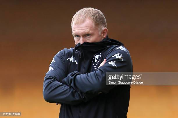 Salford caretaker manager Paul Scholes looks on with his hoodie up over his face during the Sky Bet League Two match between Port Vale and Salford...