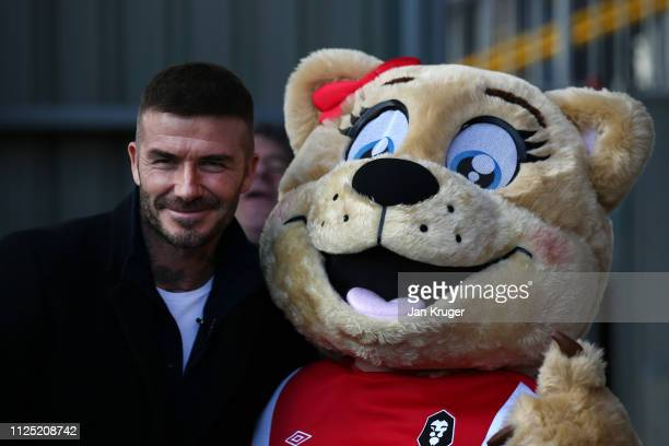 Salford City Co-Owner David Beckham poses for a photo with the Salford City Mascot prior to during the Vanarama National League match between Salford...