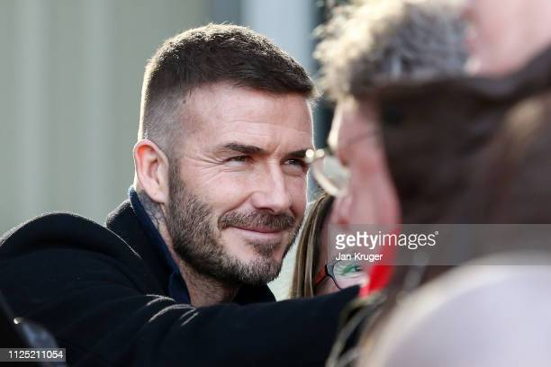 Salford City CoOwner David Beckham signs autographs as he arrives at the stadium prior to the Vanarama National League match between Salford City and...