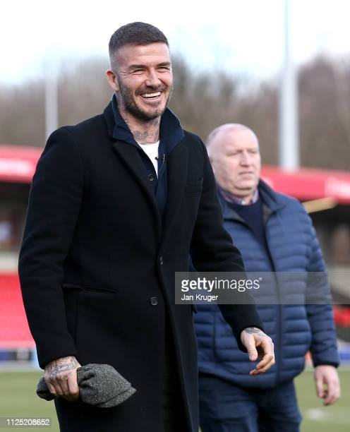 Salford City CoOwner David Beckham takes a look around the pitch prior to the Vanarama National League match between Salford City and Dover Athletic...