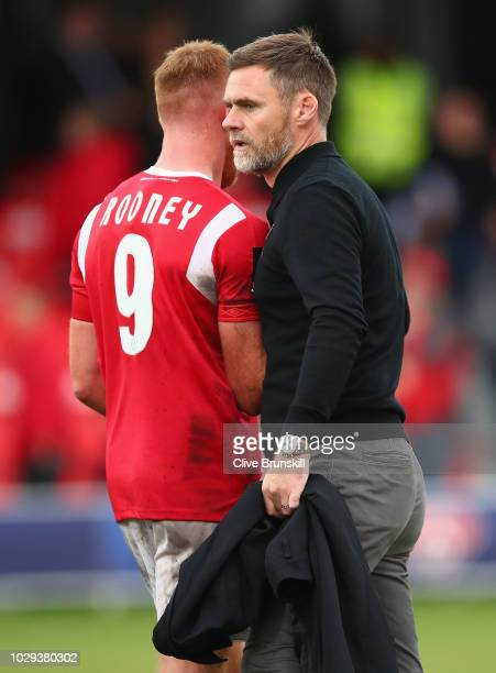 Salford City manager Graham Alexander with his captain Adam Rooney at the final whistle during the Vanarama National League match between Salford...