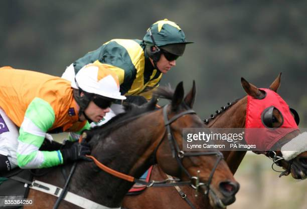 Salford City ridden by Barry Geraghty goes on to win the Timothy Hardie Jewellers Novices' Chase ahead of Astarador ridden by Denis O'Regan who...