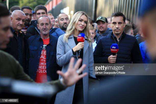 Salford coowner Gary Neville stands alongside Sky Sports television copresenter Laura Woods before the Carabao Cup First Round match between Salford...