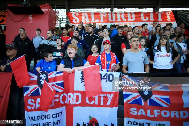 Salford fans cheer their team on during the Carabao Cup First Round match between Salford City and Leeds United at Moor Lane on August 13 2019 in...